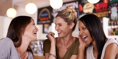 landscape-1433812400-friends-laughing-together-in-a-cafe