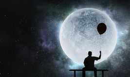 feeling-lonely-world-mixed-media-fat-man-sitting-bench-against-full-moon-background-96551139