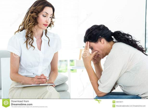 depressed-woman-talking-to-her-therapist-women-white-background-53072071